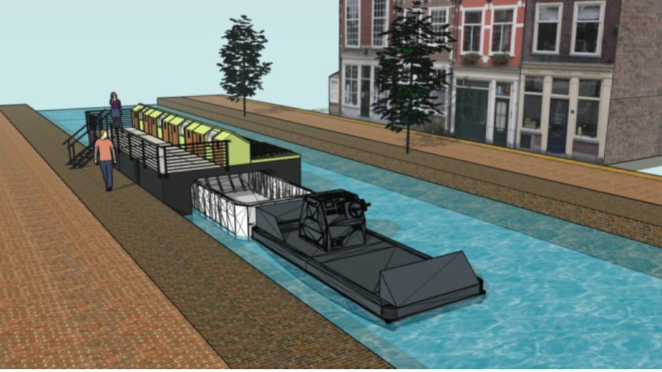 Primeur elektrische duwboot op de grachten in Delft